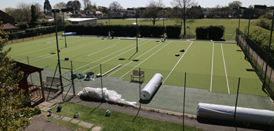 All 3 courts being laid with new artificial grass surface at Stoke Poges, Bucks