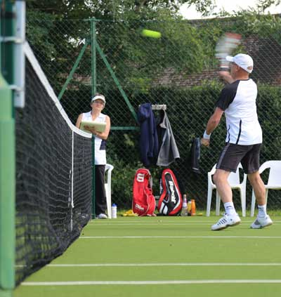 Graham-Roper-forehand-smash during mens doubles final match in Stoke Poges Tennis Club Championships