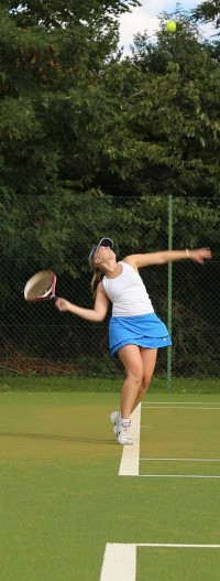Jenny-Milne-ball-toss-during service action in match
